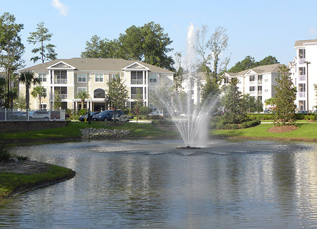 Extraordinary living at Abberly at West Ashley in Charleston, South Carolina photo of lake fountain