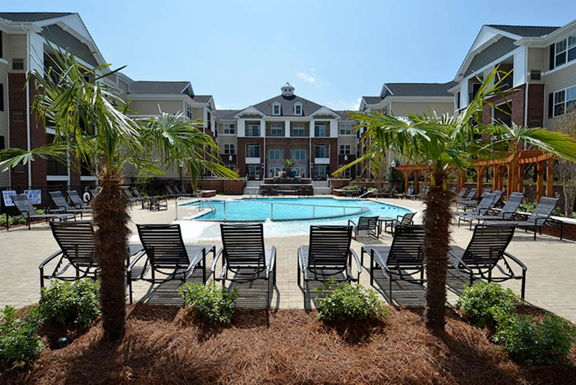 Abberly Village in West Columbia, Sourth Carolina photo of pool clubhouse and surrounding apartments