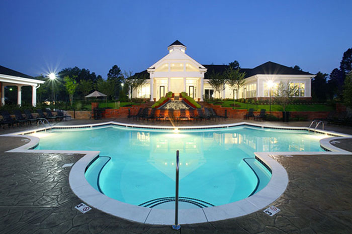 Abberly Green Apartments in Mooresville North Carolina clubhoue and pool at dusk